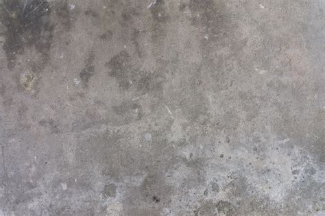 Dirty concrete wall covered with stains   Concrete