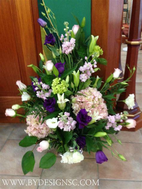 pink  purple church flower arrangement alter flowers