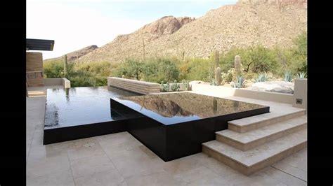 vanishing edge pool and spa in black granite