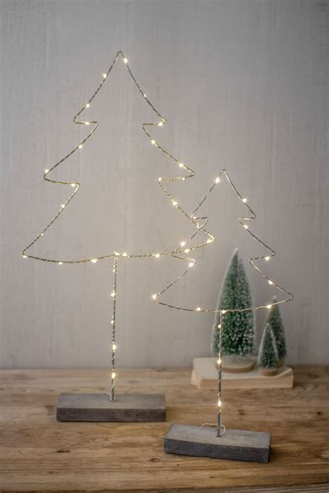 Love to create beautiful decoration items with old and mostly waste material. Set of two metal tree with led lights and cement base   metal tree wall decor & sculpture ...