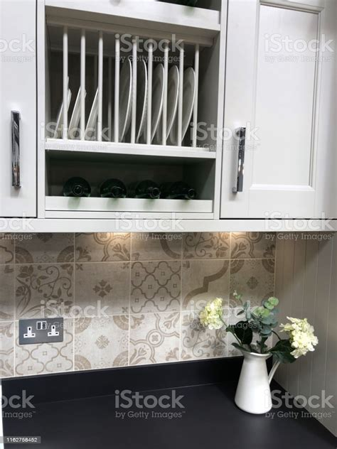 image  traditional wooden kitchen cabinets painted white grey  fitted plate rack shelving