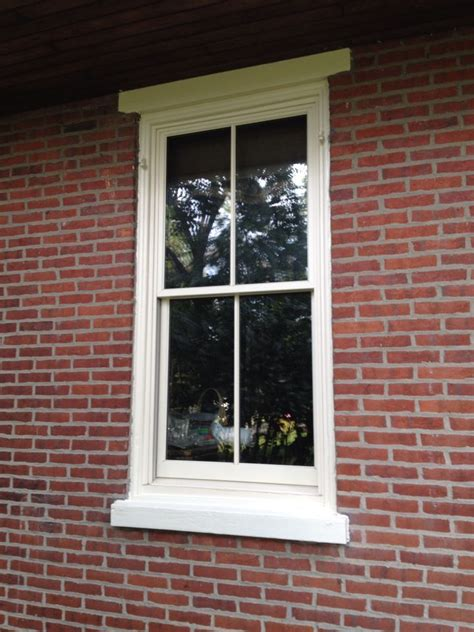 pella architect series replacement window installed year brick farmhouse original