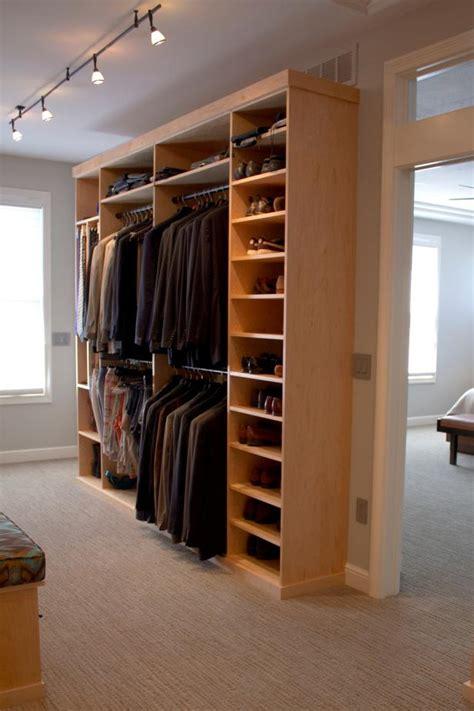 contemporary master suite walk  closet features coat