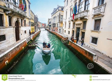 Boat Sailing In Italian Water Canal Editorial Image