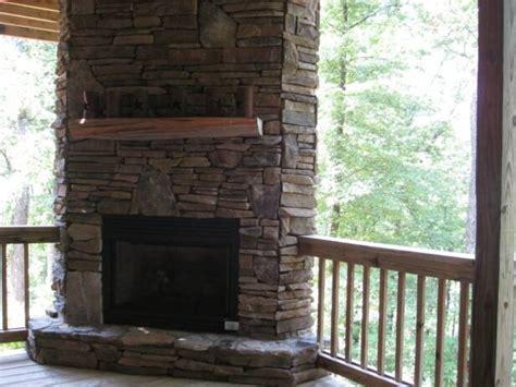 deck corner stone fireplace  deck home building