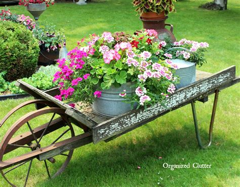 wheelbarrow planter ideas rustic garden wheelbarrow 2015 organized clutter