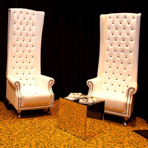 white leather highback armchair ten and a half thousand