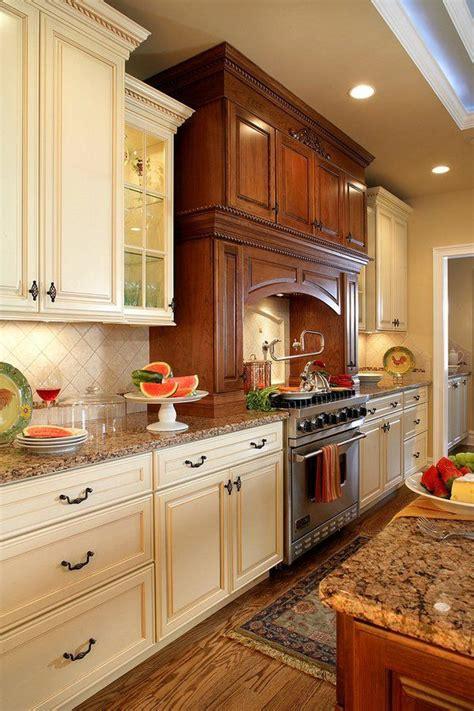 antique white kitchen cabinets baltic brown granite