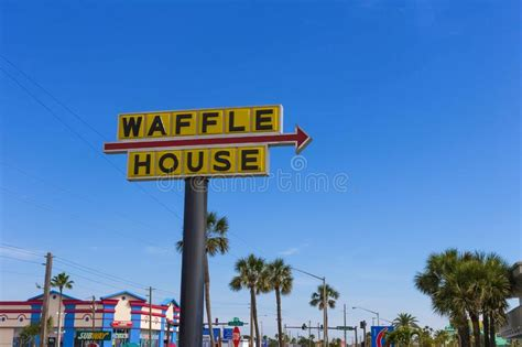 waffle house on american way one way sign against a wall background stock photo image