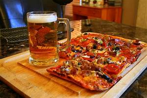 Pizza And Beer Photograph by Kay Novy