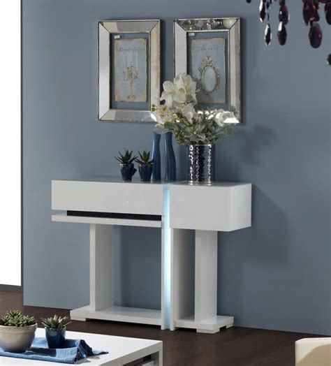 small contemporary modern white console table with storage on hardwood floor tiles for