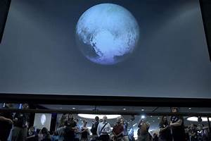US spacecraft survives close encounter with Pluto | World ...