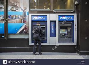 Man Uses A Citibank Atm On The Sidewalk In Midtown