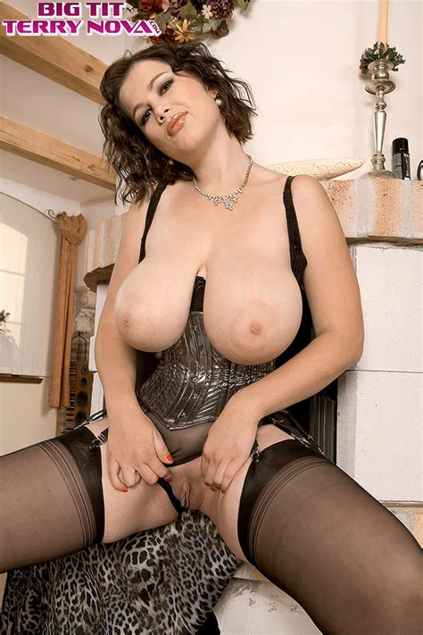 Sassy Milf Terry Nova Proudly Exposes Her Massive Knockers In A Tight Girdle