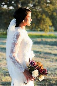 love this bride39s lace sleeves www7centerpiecescom With budget friendly wedding photographers