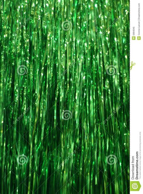 green tinsel background royalty  stock photo image