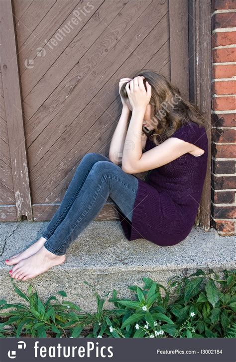 sadness expressions teenage girl  doorway stock image