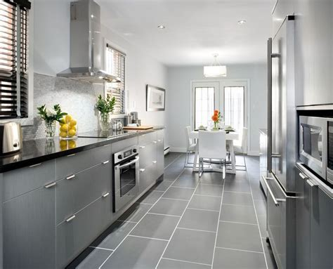 grey cabinets  black counters wood floors