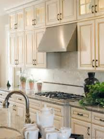 Backsplash With White Kitchen Cabinets Antique White Kitchen With Wood Floors And An Island Sink