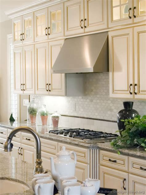 Backsplash Ideas For Antique White Cabinets antique white kitchen with wood floors and an island sink