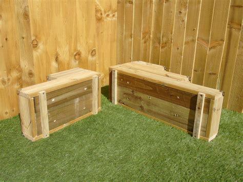 large  tiered corner garden level steps wooden decking