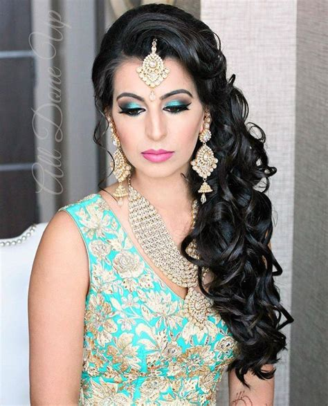 indian hair style gorgeous kundan jewelry paired with a bright teal lehenga 2816