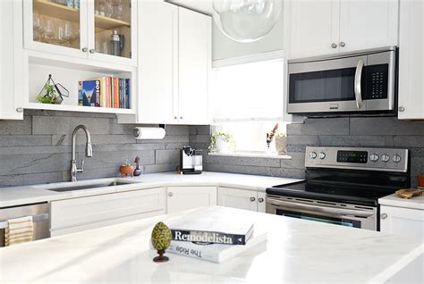 Small Tile Backsplash In Kitchen by Large Format Tile In Small Spaces