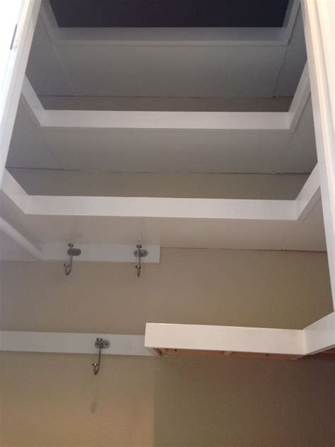 shaped floating shelves  hall closet hall closet