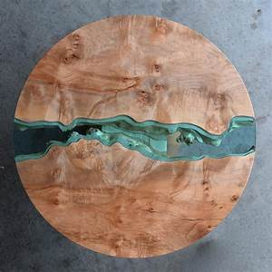 Wood tables and wall art embedded with glass rivers