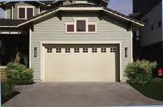 9x10 garage door with custom wood columns cedar shakes and
