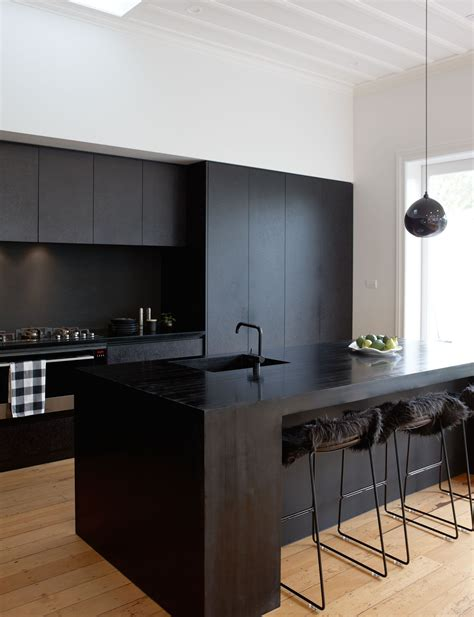 a matte black kitchen makes a bold statement in this