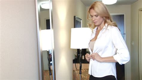 Pretty Blond Business Woman Getting Dressed For Work In