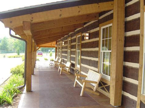 Log Cabin Home Interiors - angelic exterior house with rustic front porches also arm chairs made of wooden material beside