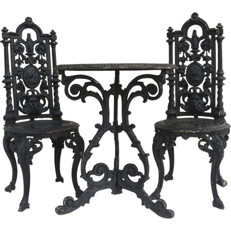 american cast iron garden table and two chairs from