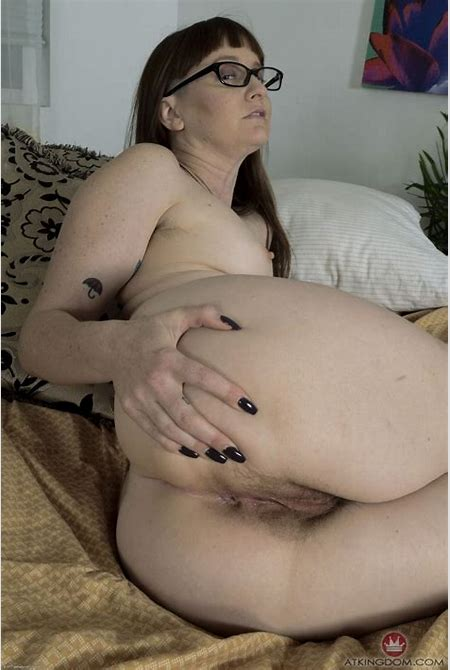 Small-tittied MILF with glasses strips in hairy moms pics