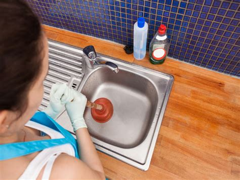 Unclogging Kitchen Sink Naturally by Diy Ways To Unclog A Sink Naturally Boldsky