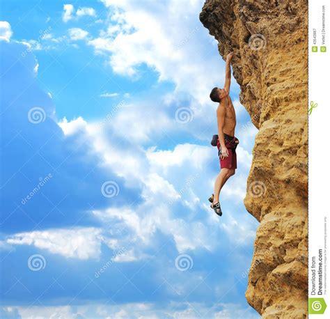 guy hanging  rock stock photo image