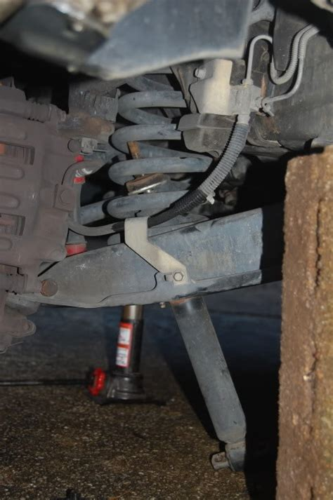 ford   questions    replace front shocks