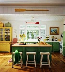 20 modern kitchens decorated in yellow and green colors for Kitchen colors with white cabinets with john lennon wall art