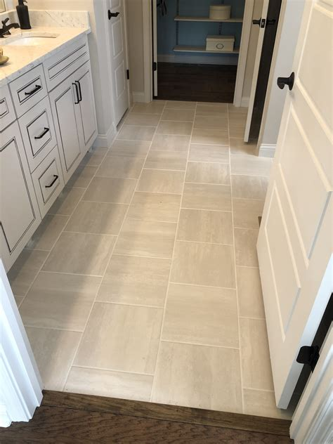 cove creek  gray floor tile installed brick joint