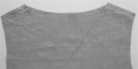 Lay your garment flat on your work surface front side up and inside out. Sewing Glossary: How to Sew a Facing to a V-Neckline ...