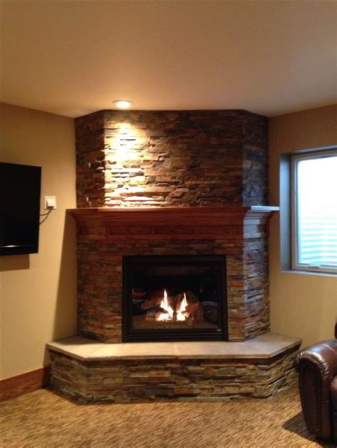 wood burning corner fireplaces basement fireplace like the idea of the 3 sides to give
