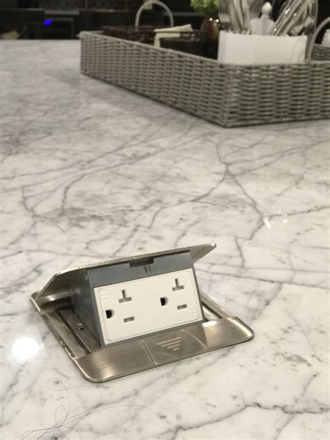 constructing kitchen cabinets pop up island electric outlets for in griddle 2444