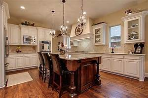 Use of mini chandeliers as pendant lights for kitchen over
