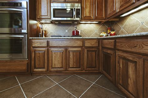 kitchen floor ideas with cabinets brown kite shape tile floor combined with brown wooden