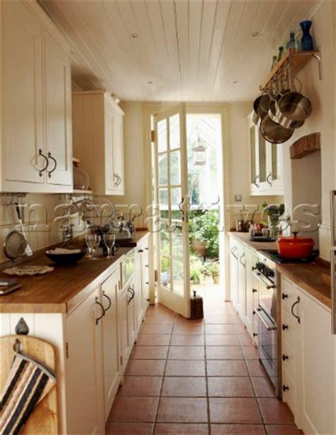 narrow kitchen ideas bd020 04 narrow galley kitchen with door opening onto
