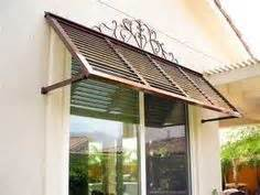 florida style key west home  construction  olde naples fl blue shutters tropical