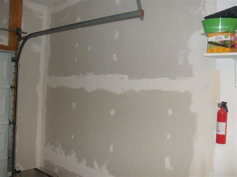 how to finish garage walls garage drywall up the of angelo