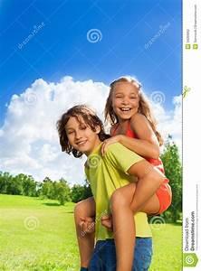 Girl Enjoying Piggyback Ride On Her Boyfriend Royalty-Free ...
