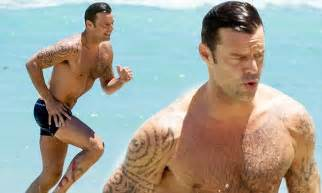 Ricky Martin shows off banging body in tiny swim shorts